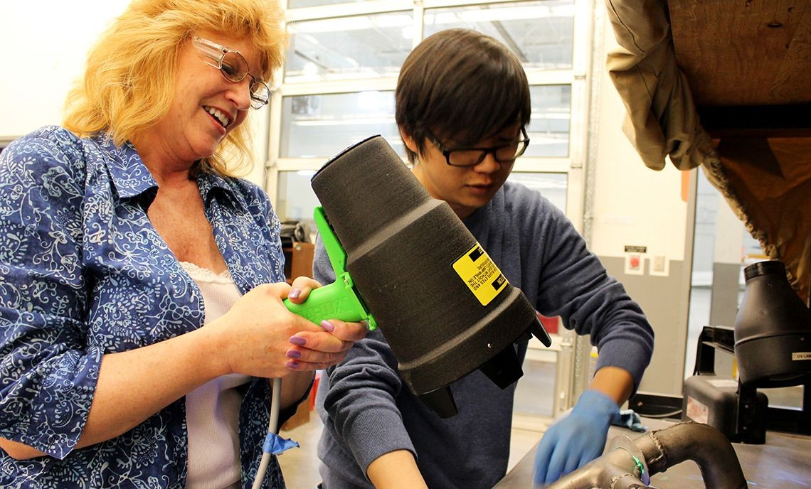 Students Naomi Hoff, left, and Kyong Kyu Mun perform a Liquid Penetrant Test in the Non-Destructive Testing lab.