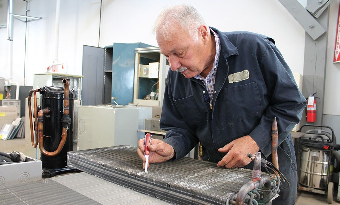 At 81, Richard Magoon is a student in Clover Park Technical College's HVAC Program, where he's working on an idea for a refrigeration project.