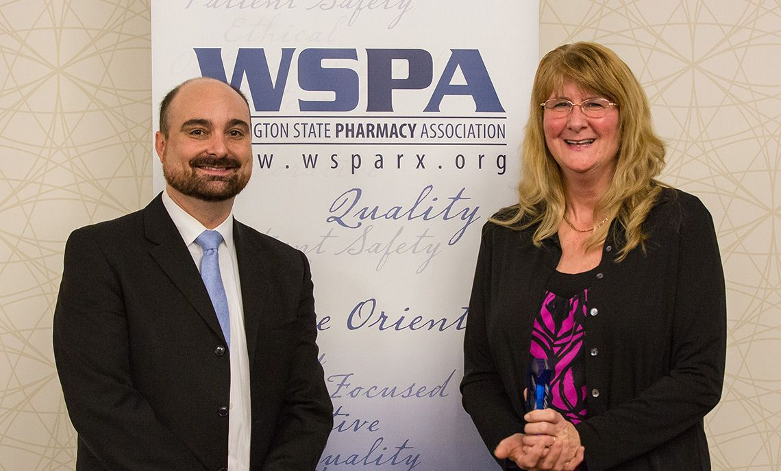 Maureen Sparks stands with Jeff Rochon, CEO of the Washington State Pharmacy Association, at the association's annual meeting. Photo by Jacqueline Garza, WSU Pharm Student '16.