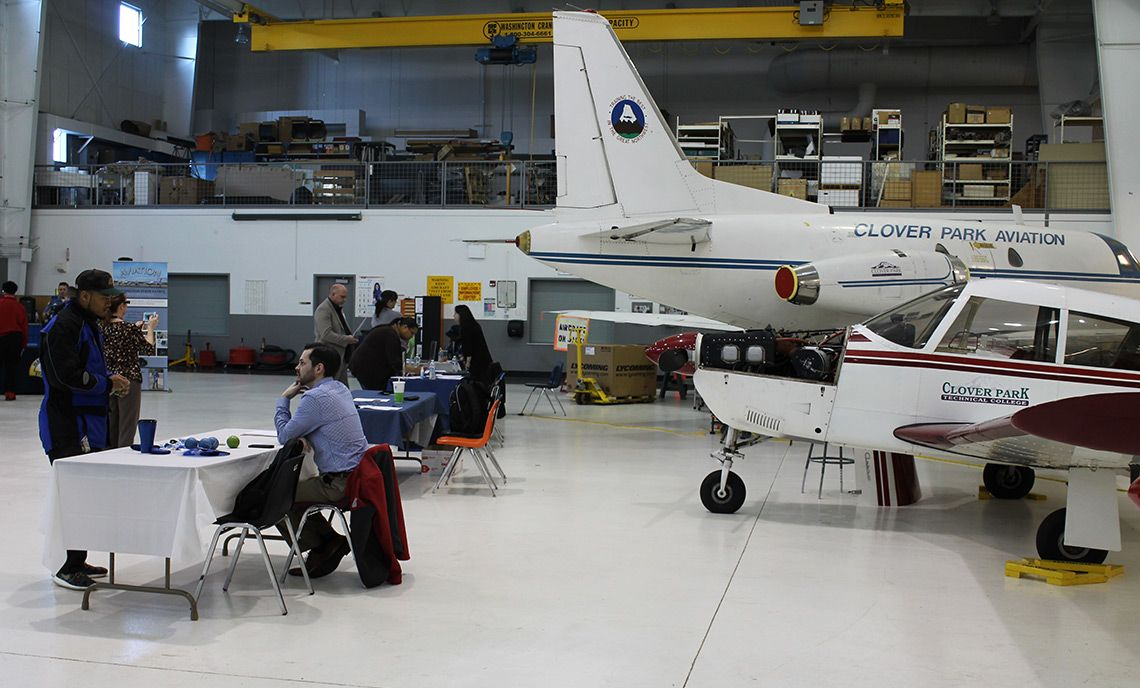 CPTC aviation hangar with info booths set up