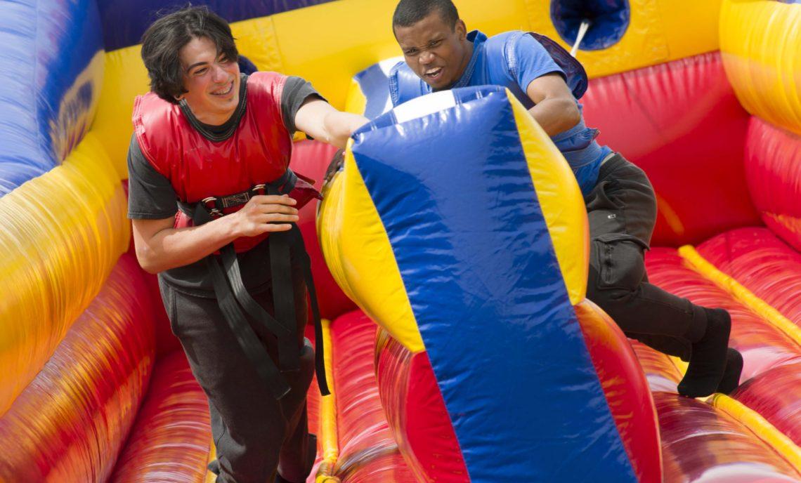 students run on a velcro bungee run