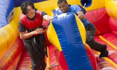 students run on a velcro bungee run