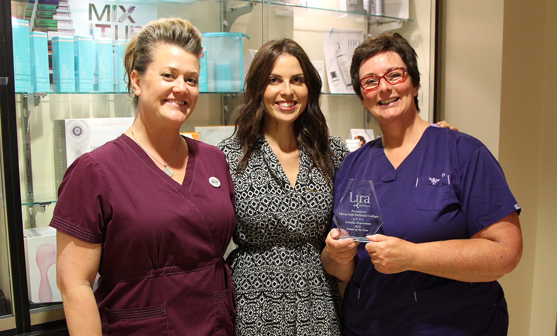 Clover Park Technical College Esthetic Science instructors Karlee Sorensen (left) and Melissa Siedlicki (right) accept the Lira Clinical School of the Year award from Lira representative Aimee Fuentes (center)
