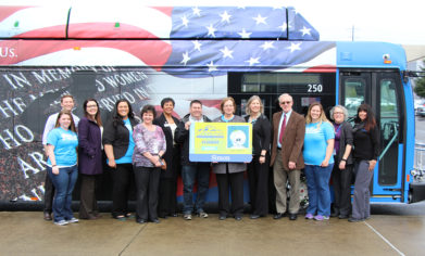 CPTC and Pierce Transit administrators and student leadership staff celebrate the unveiling of a new bus pass partnership Wednesday, April 12.
