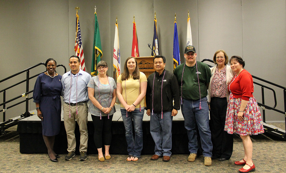 CPTC student honor cord recipients stand with keynote speaker Shellie Willis (left) and CPTC President Joyce Loveday and Veterans Resource Center Coordinator Hope Stout (right).
