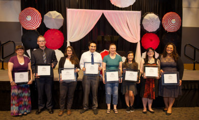 Award winners pose with their plaques following the conclusion of the Fifth Annual Student Awards Ceremony on June 7 in the McGavick Conference Center.