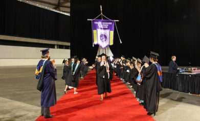 CPTC faculty form a tunnel of support as graduates make their way to the Tacoma Dome floor for the 21st Commencement Ceremony on June 20.