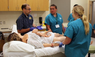 CPTC Nursing instructor David Bahrt discusses the birthing process with Nurse Camp attendees following a simulated birth.