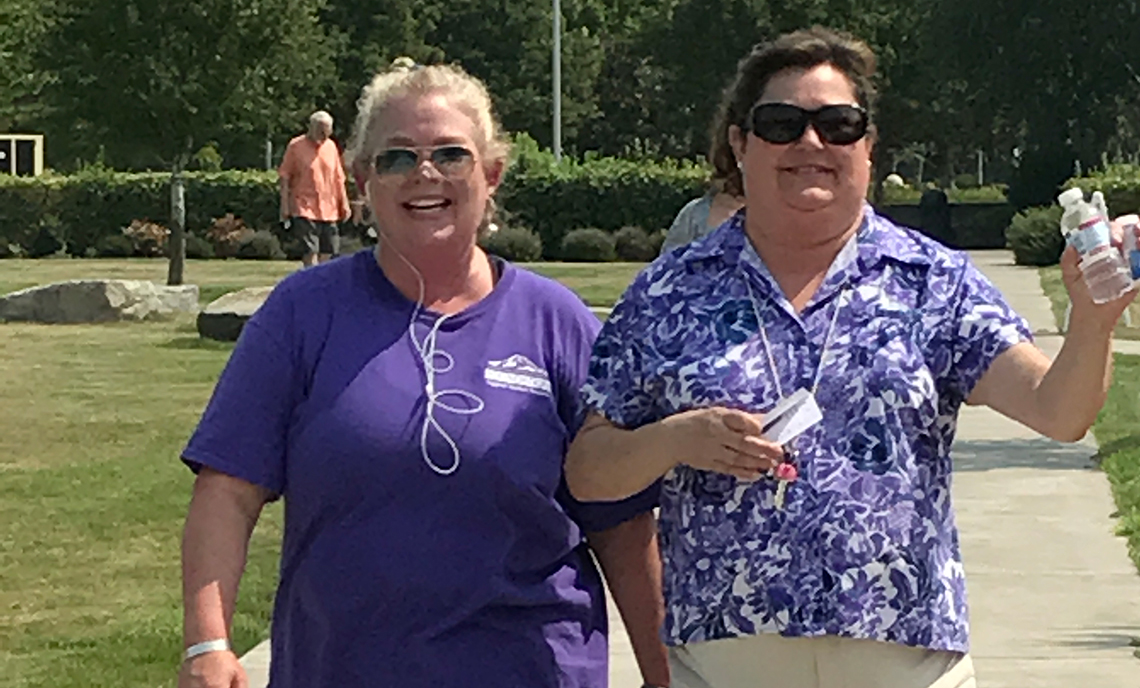 CPTC accounting instructors Suzanne Cooke and Lucy Dorum walking on the Walk-A-Thon path Wednesday, Aug. 9. Cooke completed fellow instructor Wayne Bridges' challenge to walk five miles in one day.