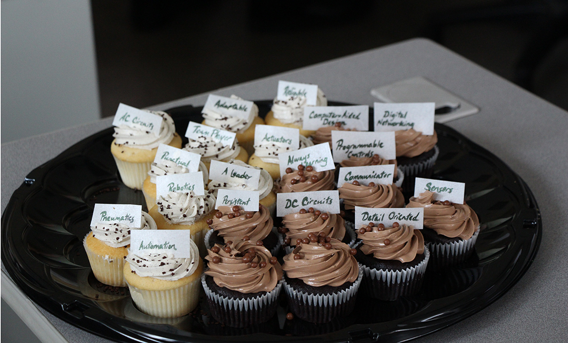 Trays of cupcakes prepared by CPTC's Pastry Arts program featured listings of competencies taught in the Mechatronics program.