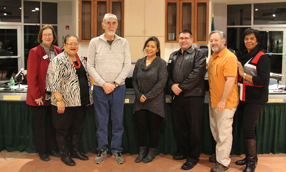 Clover Park Technical College Trustees and President Dr. Joyce Loveday pose with Health Unit Coordinator instructor Joylene Perez after awarding Perez tenure at the December Board of Trustees meeting.