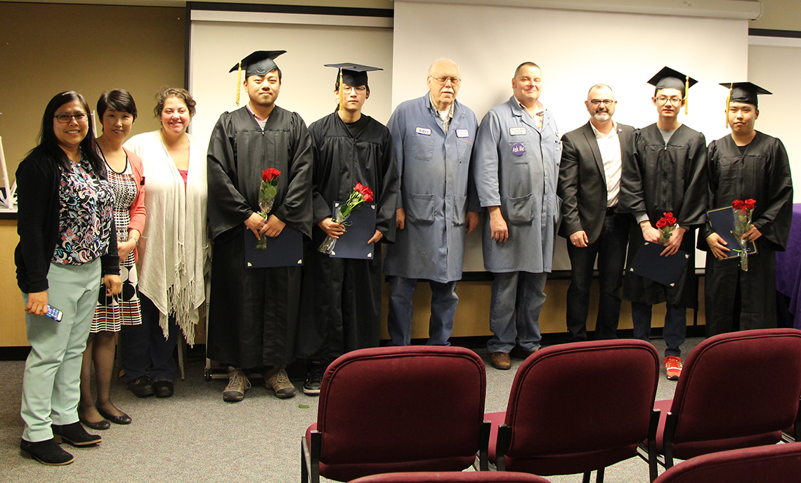 CPTC's four Aviation Maintenance Technician international student graduates join instructors and Student Success staff members to celebrate the conclusion of their program.