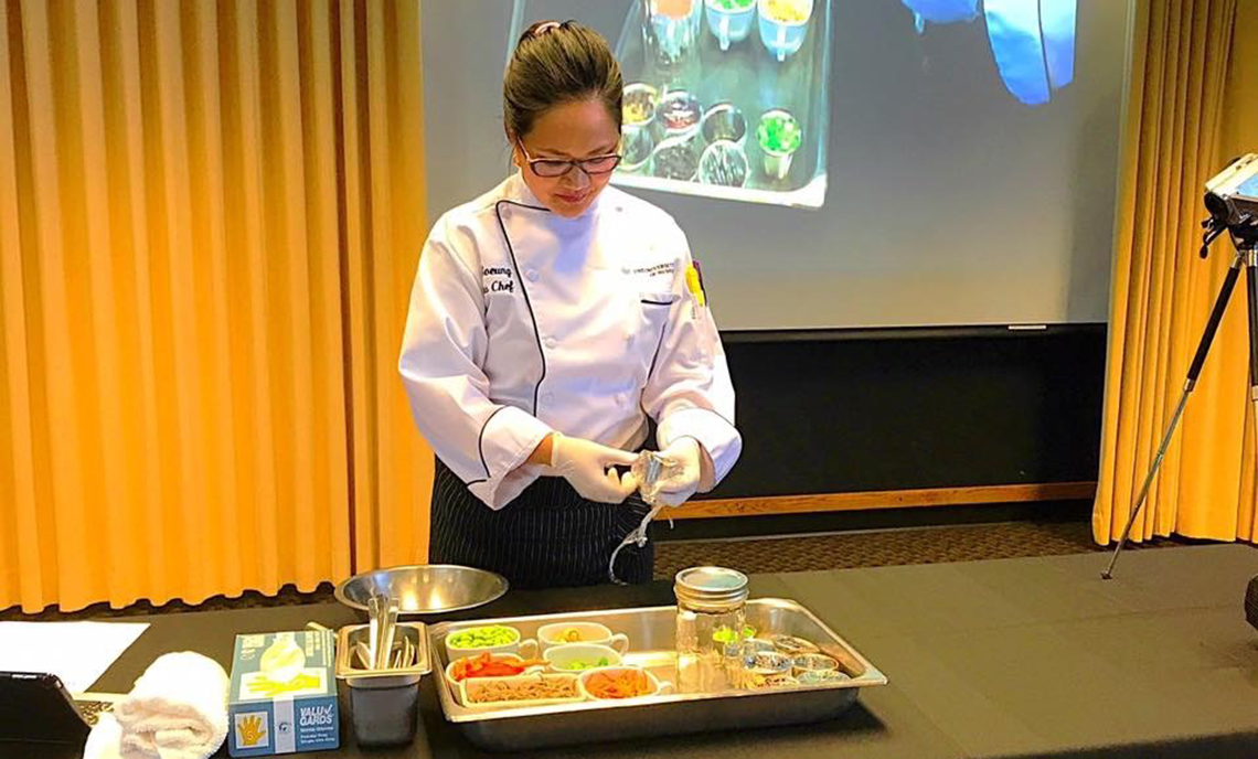 CPTC Culinary Arts alum Jo Soeung conducts a culinary demonstration.