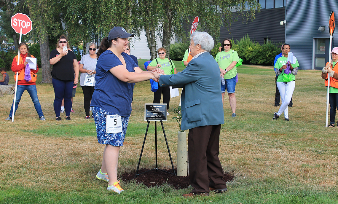 CPTC Environmental Sciences & Technologies Instructor Kathryn Smith and Col. Edward Smith place a commemorative plaque next to the Garry Oak planted in honor of Andy Fritz.