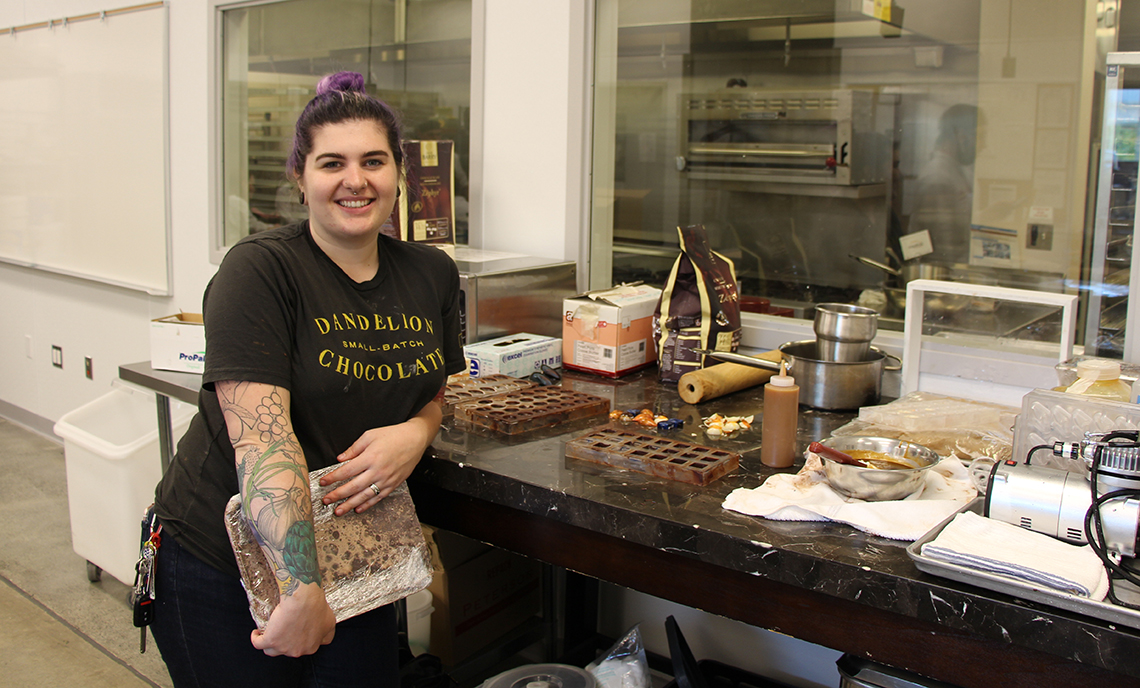 Clover Park Technical College Pastry Arts alum Mollie Stewart experiments with different color and flavor combinations for her chocolate creations.