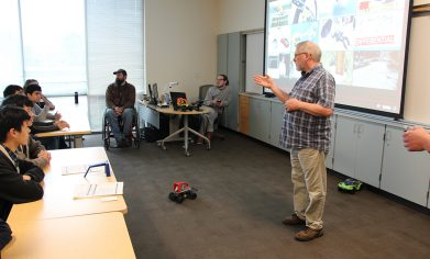 """CPTC Computer Programming instructor Ken Meerdink leads a breakout session showcasing the """"Donkey Car"""" built by the his program to transform ordinary remote control cars into autonomous vehicles."""