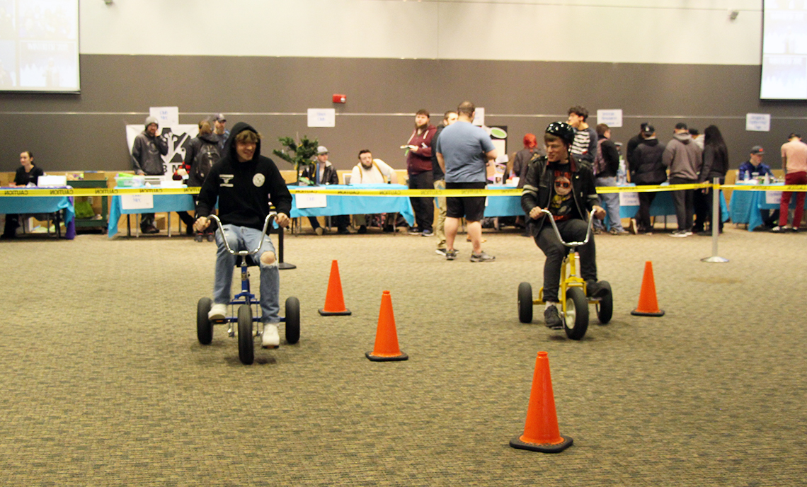 Winter Fest attendees race on the oversize tricycles.