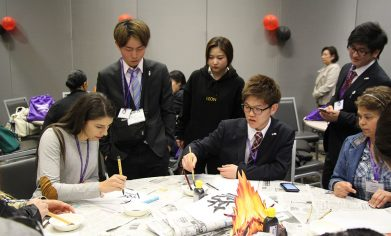 Osaka Jikei students teach CPTC students how to write in Japanese Calligraphy.