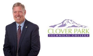 Man in suit looking at camera and CPTC logo