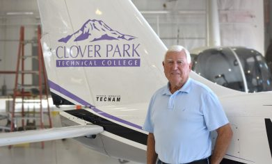 John Schell in front of CPTC airplane