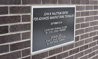 Plaque displayed outside for CPTC's newest addition, the John W. Walstrum Center for Advanced Manufacturing Technology.