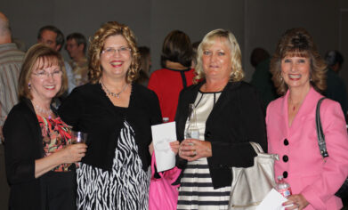 Chris Lewis (in pink) at Dr. John W. Walstrum's retirement