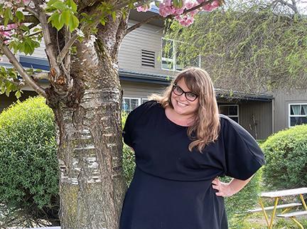 Rachael Butler next to a tree