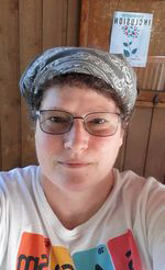 Headshot of Marcia Wilson wearing a grey bandana