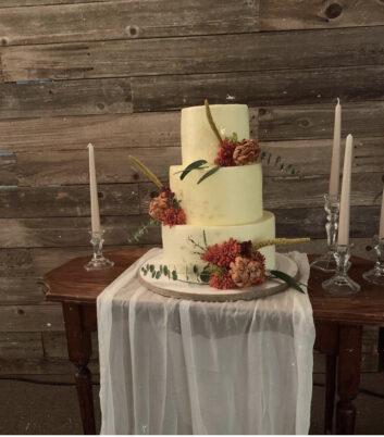 three- tiered white wedding cake