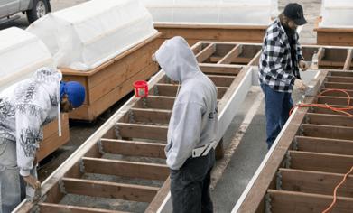 Construction technology program students working on the Zero Energy House